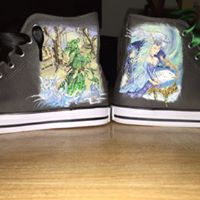 fairy shoes on a dark converse shoe, showing a green tree wizard fairy and a ablue water witch