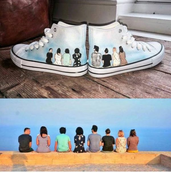 holiday memory shoes. People sat on a wall on hi top shoes. the original picture is beneath