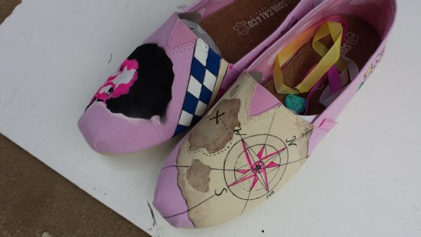 pink toms with a stencil portrait and and aged map design