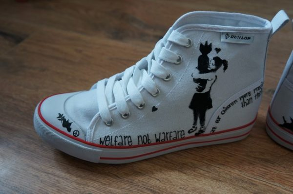 banksy girl and bomb style hi tops