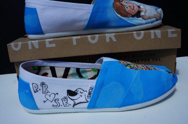 side view of some white toms and a cartoon sketch of Dug from the film Up and the initials of two people plaus a heart