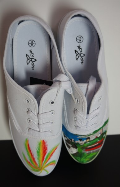 pair of shoes with jamaican coloures hemp cannabis leaf and a skyline pictre of melbourne
