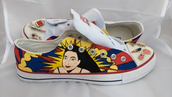 pop art picture of a lady with dark hair on the side of a shoe