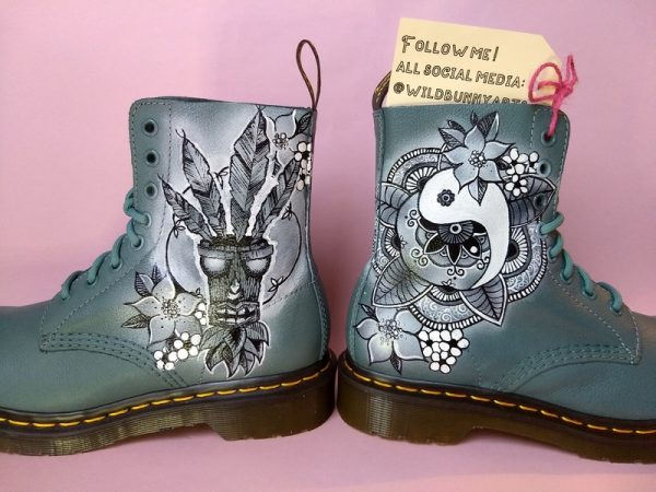 picture of some grey blue doc martens with a crash bandicoot and henna style yin yang style design