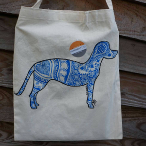 picture of a cotton tote bag with the picture of a medium sized retreiver style dog. the outline is filled in with blue henna style design.